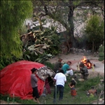 Preparing for a sweat lodge by burning 28 lava rocks, and bringing in five rounds into the small red tent for a couple of hours!.jpg