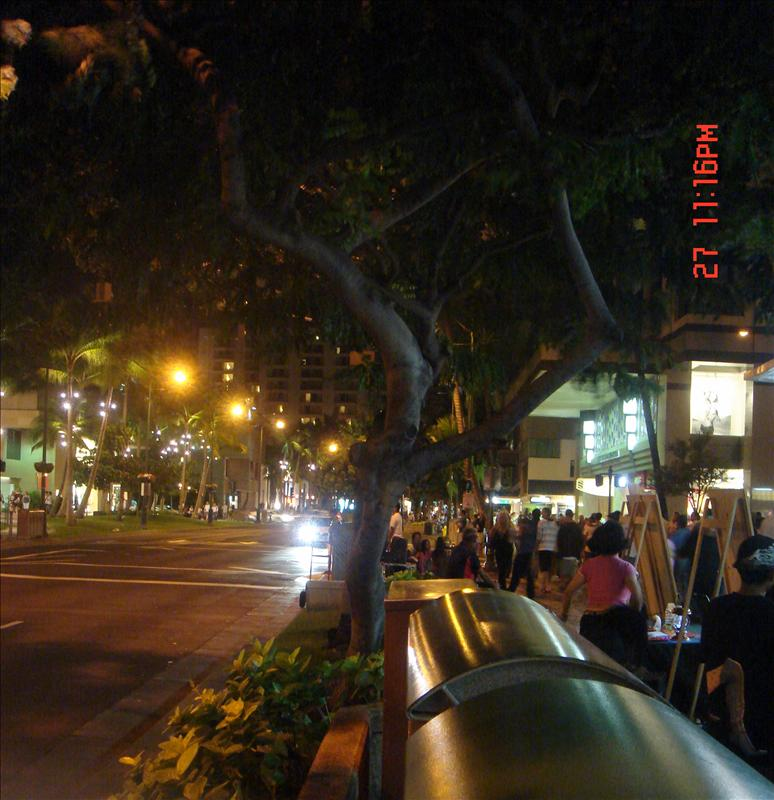 night scene on Kalakaua avenue (waikiki)