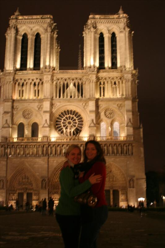Jen & Tricia in front of Notre Dame at night