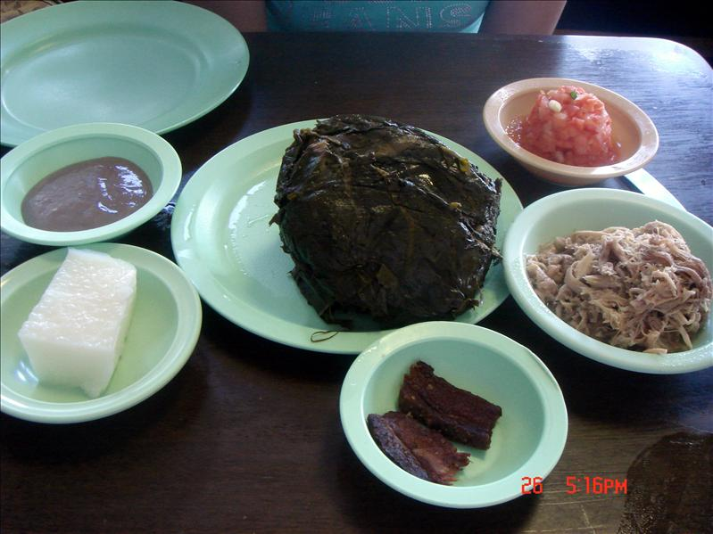 the middle one is Laulau Pig, which is some pork wrapped in some leafs, to the right is Kalua Pig (which is a shredded pork), the bottom is a beef jerky, to the top right is some kind of tomato salsa, the right bottom is a coconut pudding, and the right top is Poi , which is a mashed taro root.) Poi is by far the most terrible, because it tastes like glue