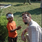 Brent with one of the little boys in the Geta village
