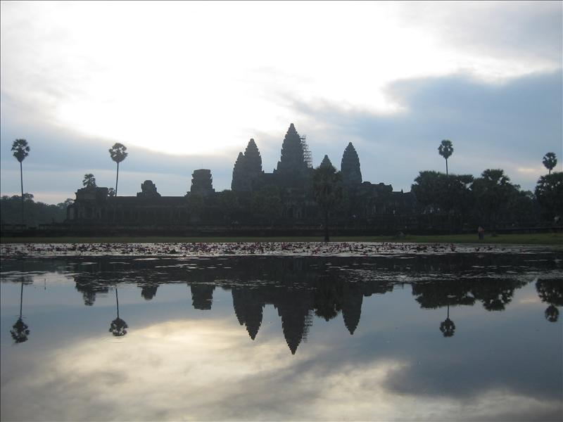 Reflection of the perfectly symmetrical Angkor Wat in the Lotus pond