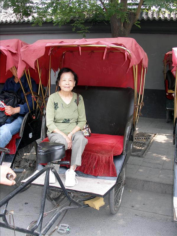 Hutong Rickshaw in Beijing. Next to my mom was our tour guide with good english, great personality, and impeccable attention to his charges. He set a tough bar for the other guides to meet. Picture taken with his face hidden was for his own protection from his competitors.