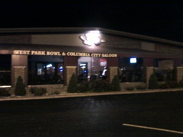 a night view of the front of the bowling alley and bar