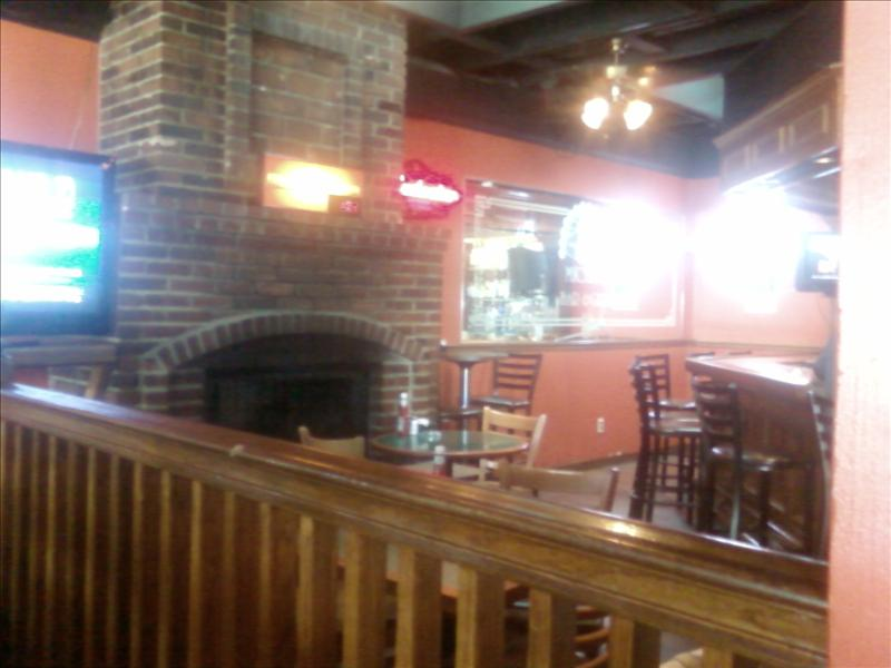 a fireplace near the main bar
