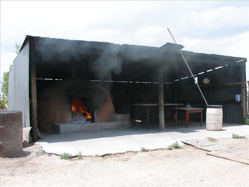 Paywa's Zuni Bread Oven. The smell of the bread sold itself. Of cause I asked for permission before I took the picture.