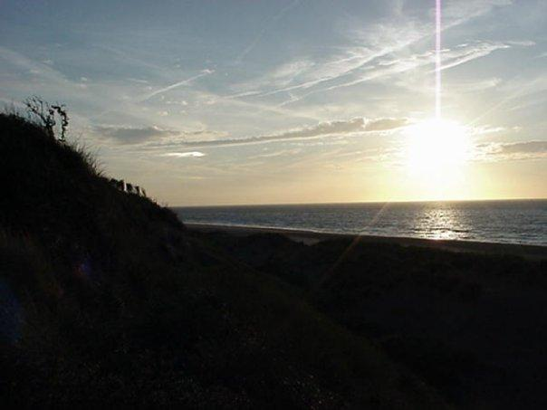very late evening and the sun sets over the north sea