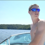 steering the boat on the Lake of the Ozarks