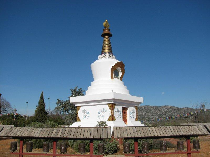 ... outside is the Estupa and prayer wheels.