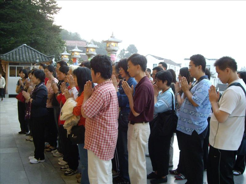 group chanting in front of the temple