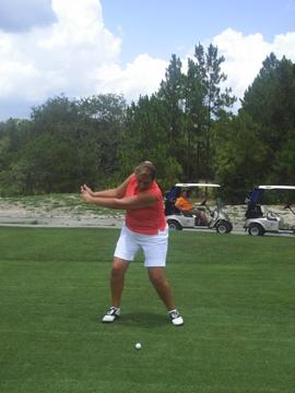 Sue teeing off