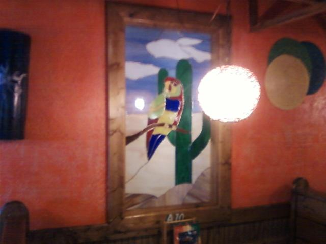 here the parrot is... a window inside the restaurant