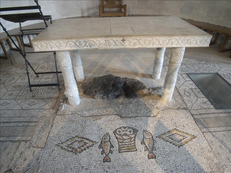 the rock where jesus laid the five loaves and two fishes that multiplied to feed 5000 faithful listeners ( mark 6:30-44 )