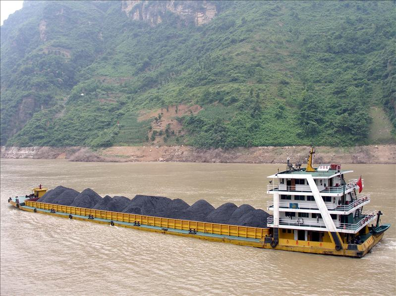 They ship coal, cars, whatever in those containers between cities along the river.