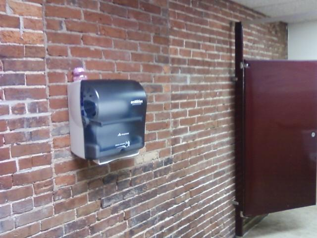 notice the brickwork in the mens restroom