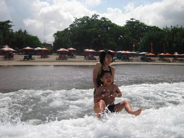 Swimming @ Legian Beach. 1st time Bryan did this. He had a blast.