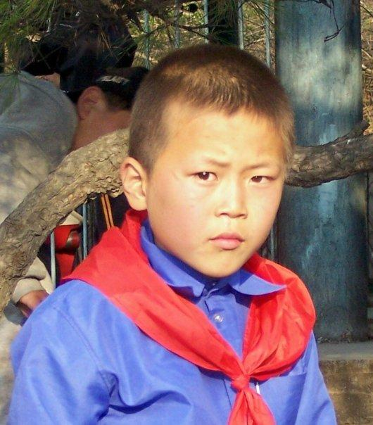 AT THE FUNFAIR, PYONGYANG - BUT NOT LOOKING TOO HAPPY