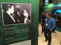 Conference attendees walk through a display celebrating 90 years.