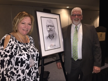 Gene Orlick collected his second Service to Industry award.