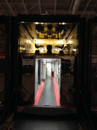 One of the Penske cars waits to be unloaded.