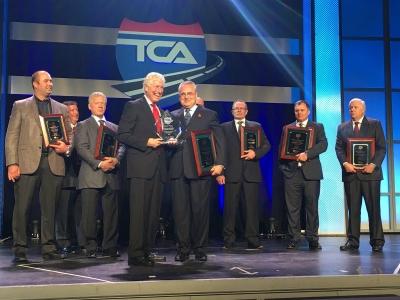 Bison's Garth Pitzel accepts award at TCA's Awards banquet - Photo Courtesy of Truck News