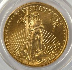 Superb Gem BU 2004 $5 Gold Eagle in custom holder.