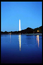 The Washington Monument at dusk reflected in the pool outside the US Capitol , Washington, D.C.