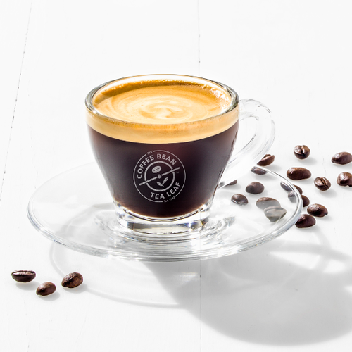 Espresso shot in glass with logo