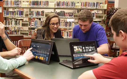 High School Students Studying in Library