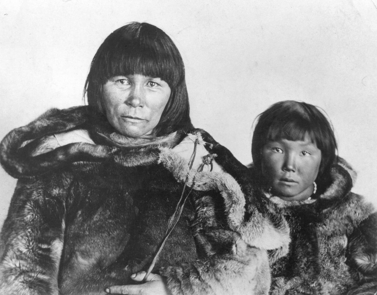 Black and white picture of an Inuit woman and her son
