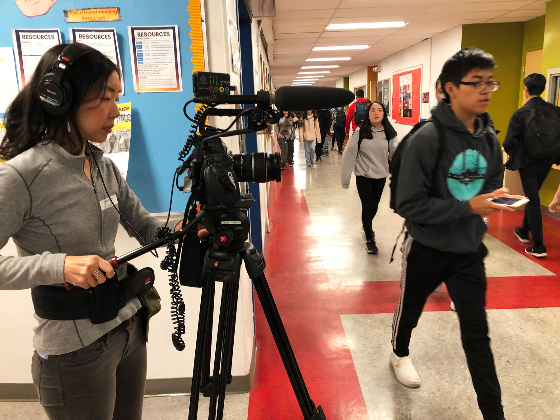 Behind Scenes shot of DP Kathy Huang filming halls of Lowell HS