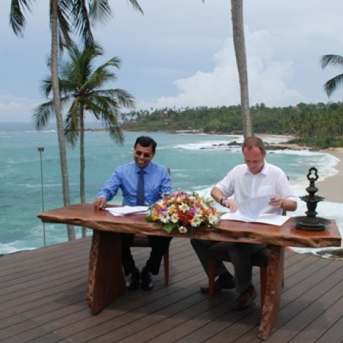 Dr Ananda Mallawatantri, Country Representative of IUCN and Mr Ross Sanders General Manager of Anantara Peace Haven - Tangalle Resort signing the agreement to mark a new beginning. Photo: Norman Zweyer