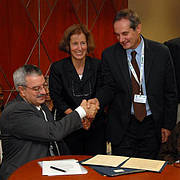Braulio Ferreira de Souza Dias, Executive Secretary of the Convention on Biological Diversity; Jane Smart, Global Director IUCN Biodiversity Conservation Group; and Piero Genovesi, Chair of the IUCN SSC Invasive Species Specialist Group sign the agreement. (Photo: Piero Genovesi)