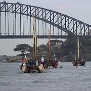 The Mua Voyage vaka canoes about to sail under the Sydney Harbour Bridge Photo: Matt Pulford