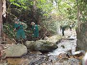 An enforcement team conduct a foot patrol in Phou Sithone ESCA. Photo: WCS Lao PDR / IEWMP