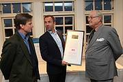 Copenhagen Zoo CEO Steffen Straede presenting HRH the Prince Consort with a framed certificate (and saola photo) explaining the gift. Photo: Michael Petersen