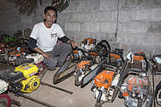 Sayan Raksachart of Freeland, with confiscated outboard motors and chainsaws, used by poachers. Photo: Ann & Steve Toon