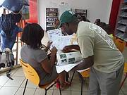 Outreach officer Robert Nkala describes some of the species in the park to a festival goer Photo: WCS