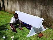 Project Assistant, Lawrence Tusiime, constructing cycad propagator Photo: Matt Cooper