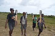 Monitors carry beach demarcating pegs. Photo: Edward Aruna