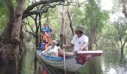Boat trip in flood forest in the Stung Sen core area. Photo: © Wild Cambodia Oranisation