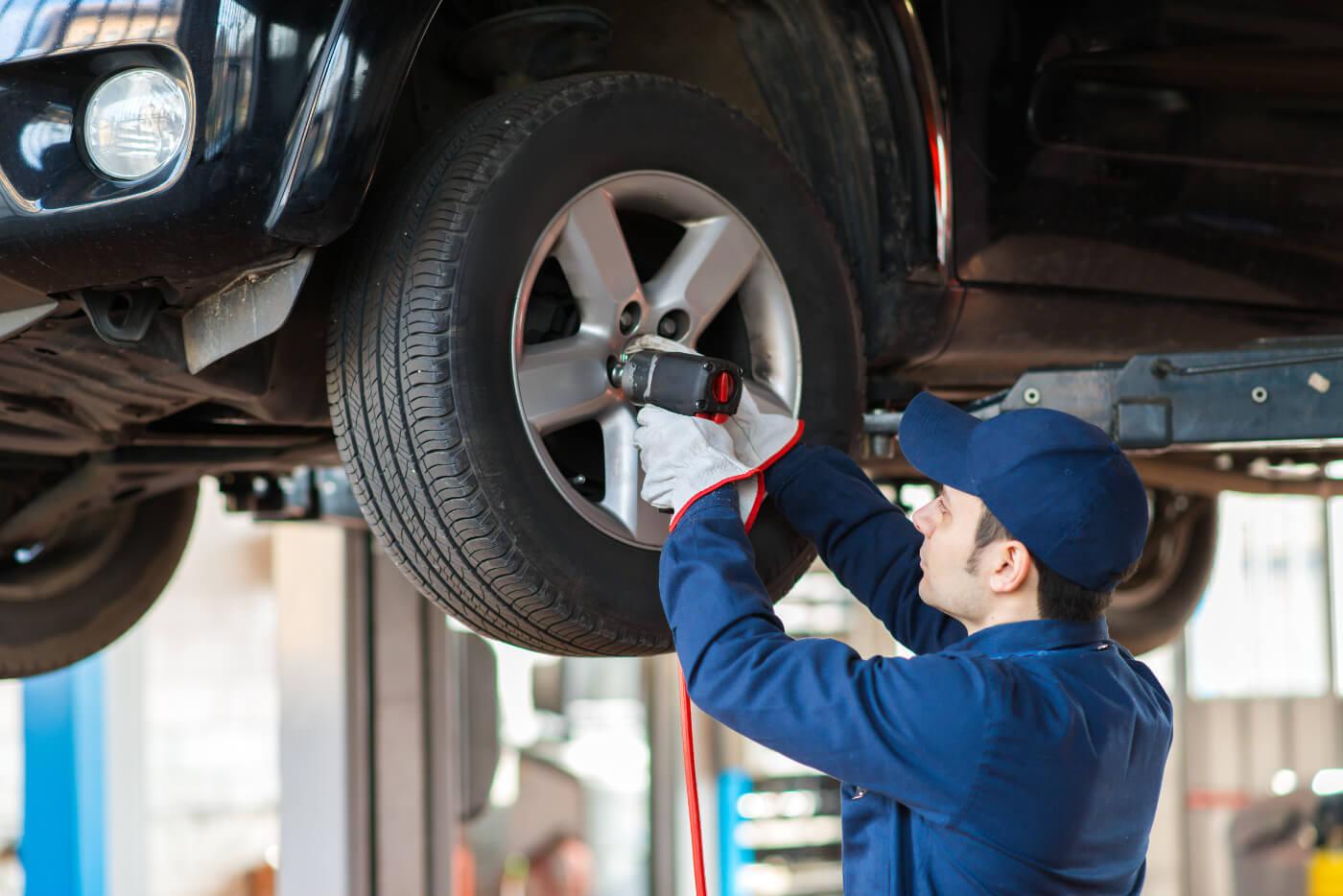 mechanic working on wheel mounted
