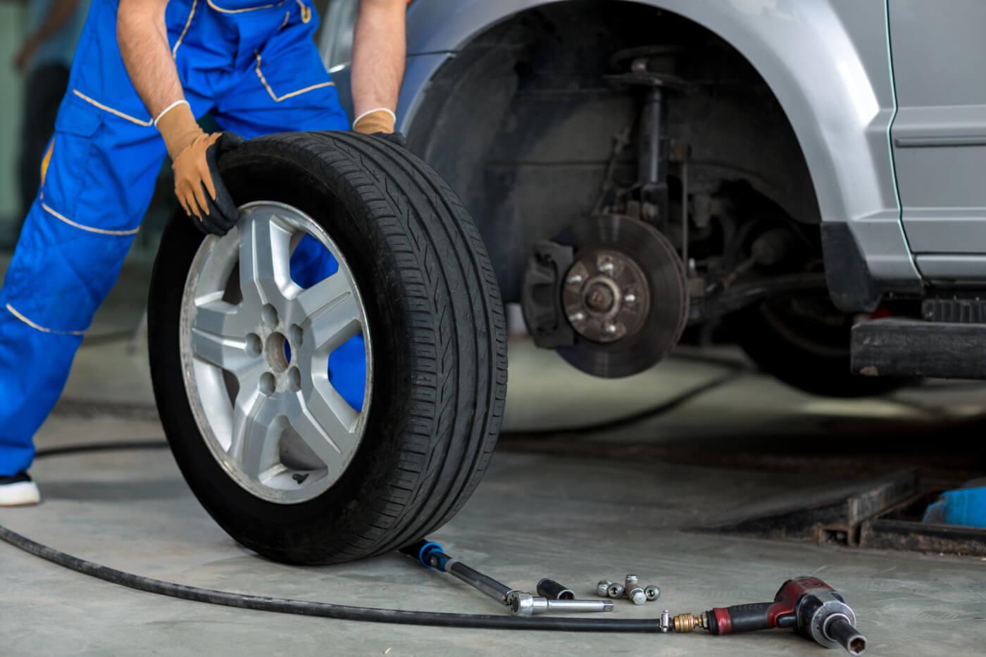 mechanic replacing a tire