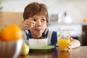 Child eating breakfast 2. image by shutterstock. 850x455