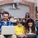Bigstock parents and kids using a lapto 129122876