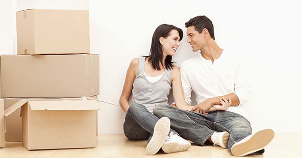 Young Couple Moving to a New Home