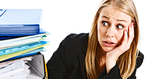 Woman-overwhelmed-by-pile-of-files