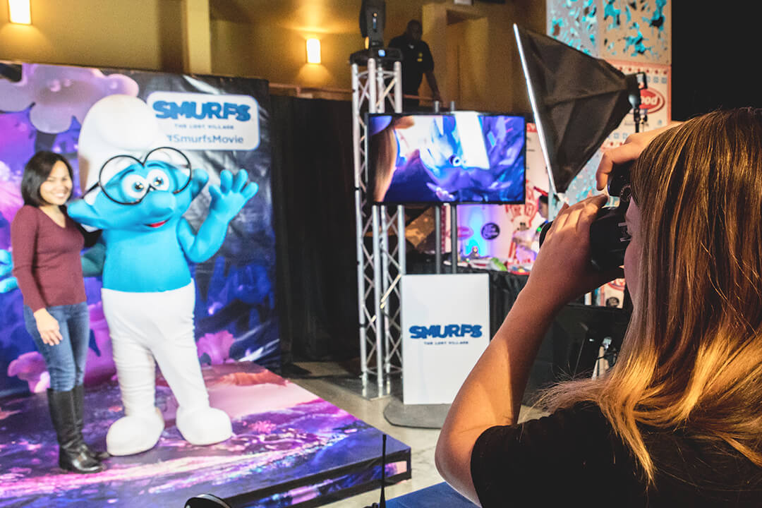 Event Photographer capturing a woman posing with a Smurf