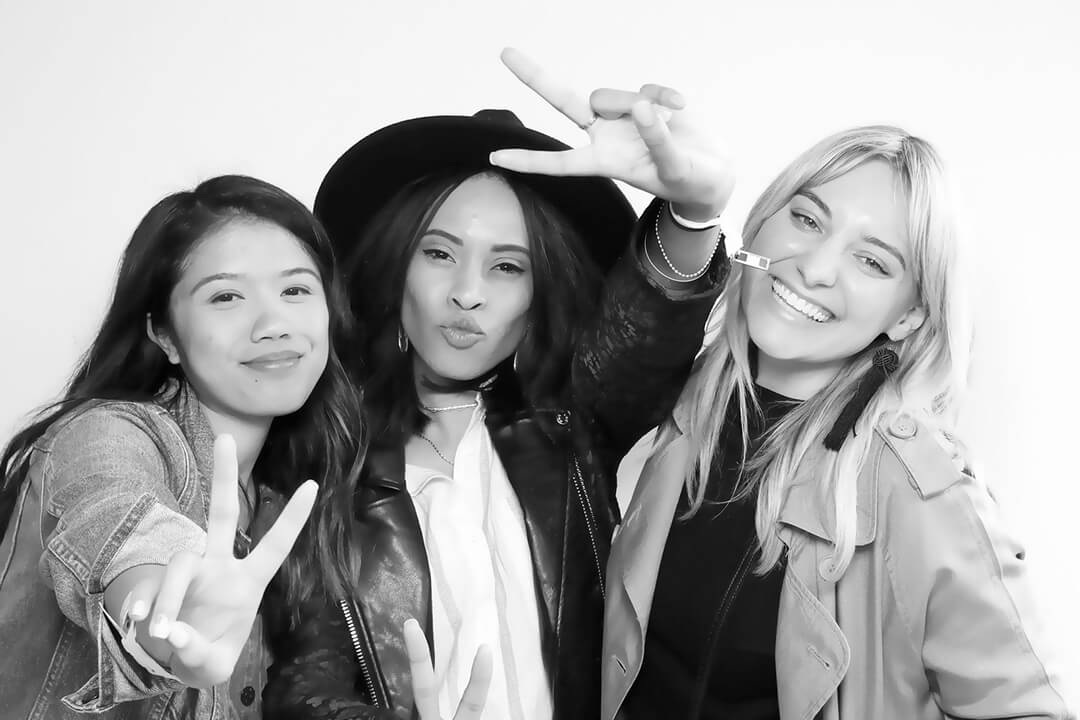 Black and White photo of three friends posing together with a skin smoothing glam filter applied to the image