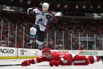 Avalanche player jumping over Red Wing